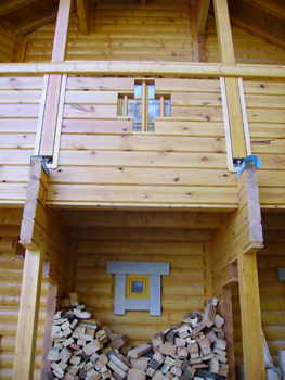 Front of log cabin with timber hatch